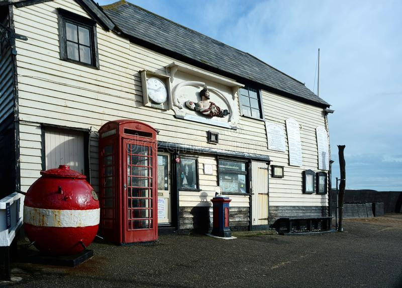 Old Lifeboat Station, red telephone box and WWII mine stock photos