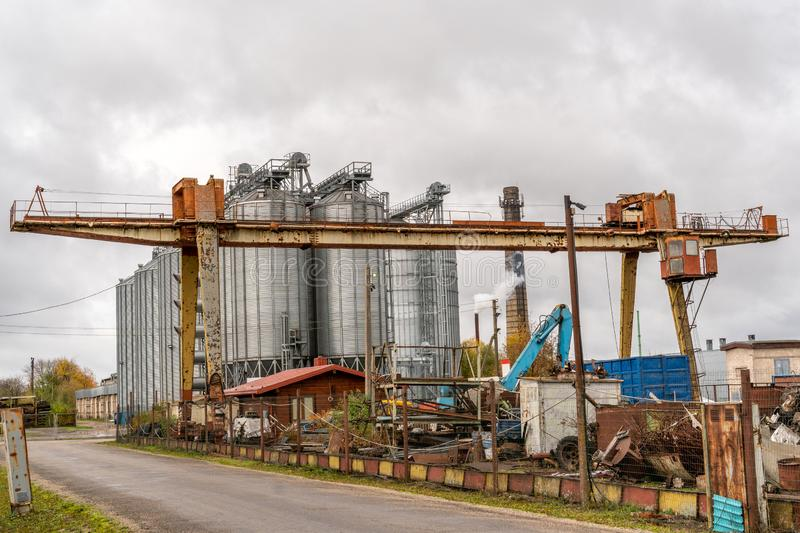 Old lifting crane in the scrapyard. Old lifting crane stands in the scrapyard stock photography