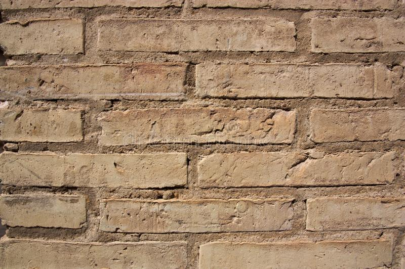 Old light brown brick wall, cinnamon stock images