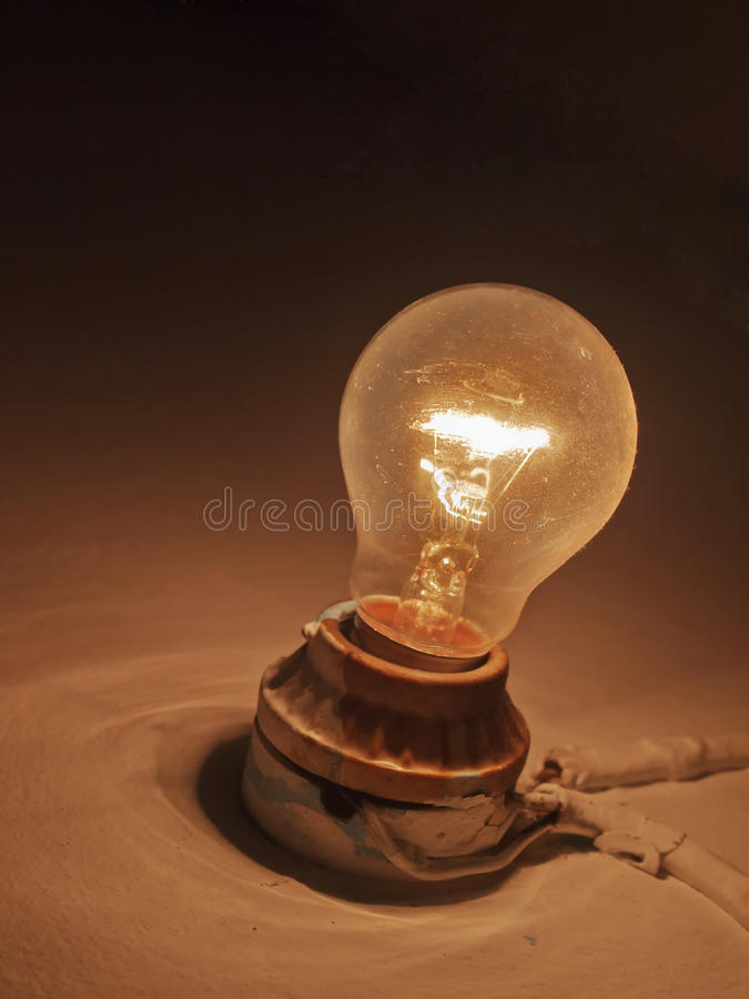 Old Light bulb on wall stock photos