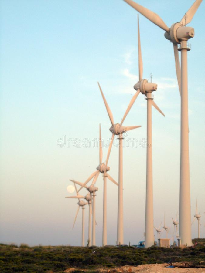 Lighthouse and wind turbines bozcaada stock photos