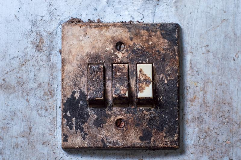 Old light switch mounted on a white wall royalty free stock image