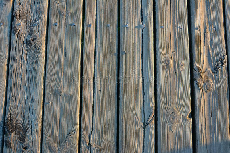 Old Light wooden board with well visible structure of wood covered with frost. Pier in Sopot, Poland, the Baltic Sea winter sunrise stock photo