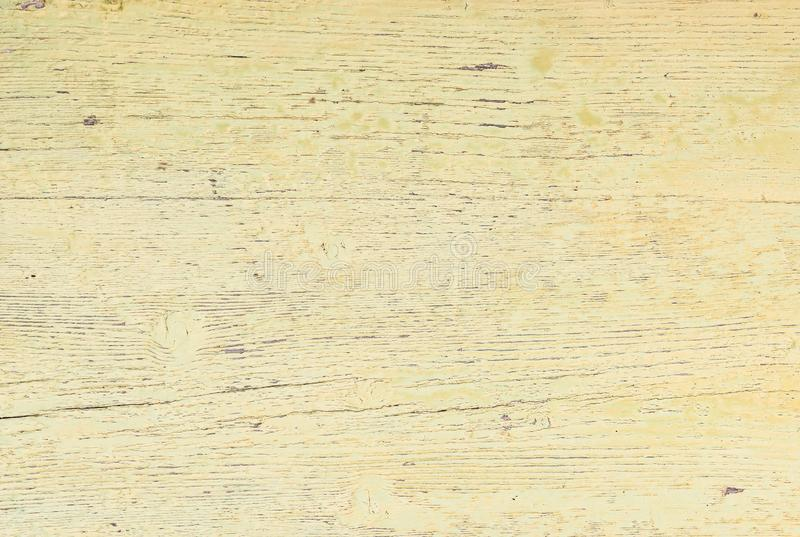 Old light yellow colored wood texture, close-up royalty free stock photo