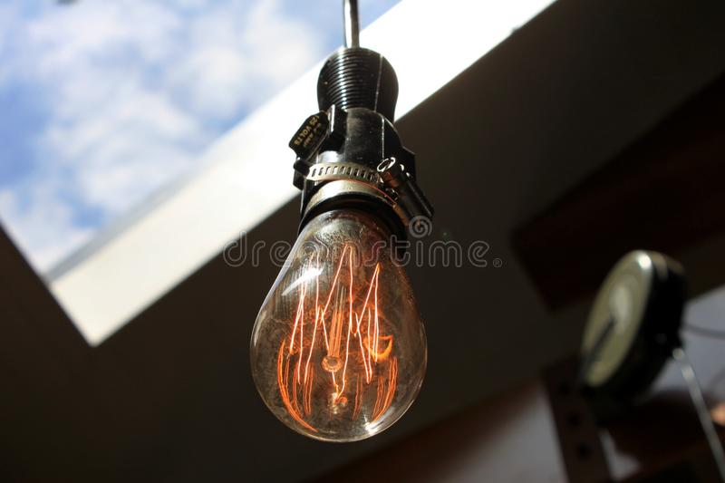 An old lightbulb on overhead stock images