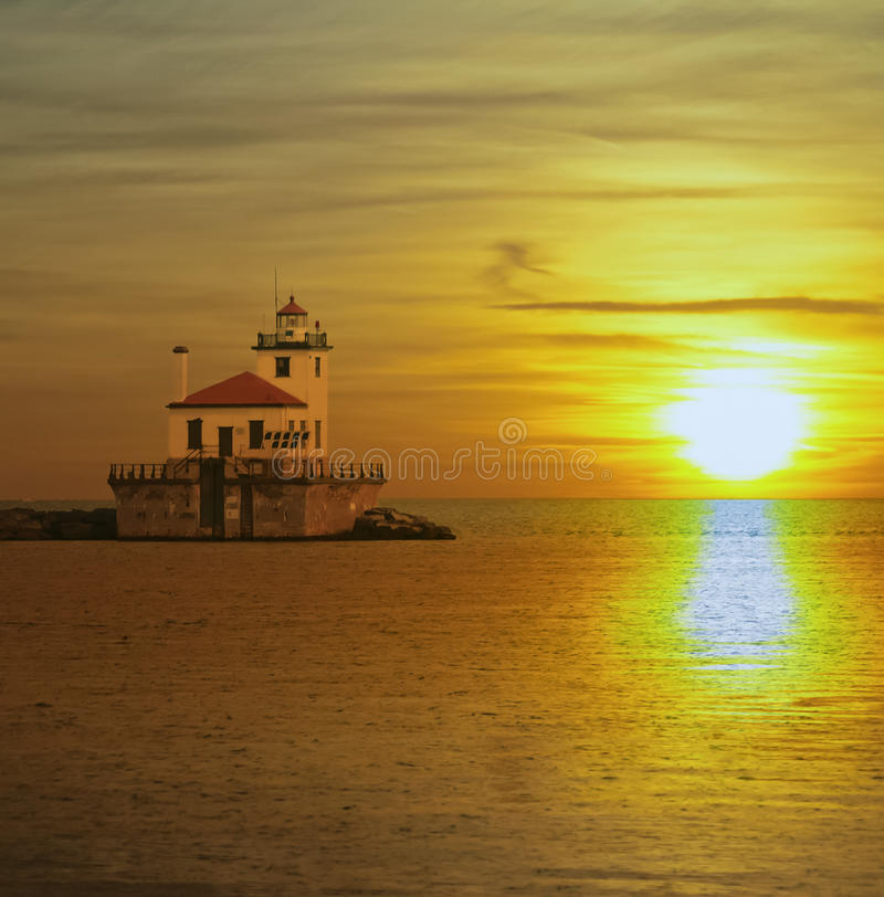 Old lighthose and sunset royalty free stock photography
