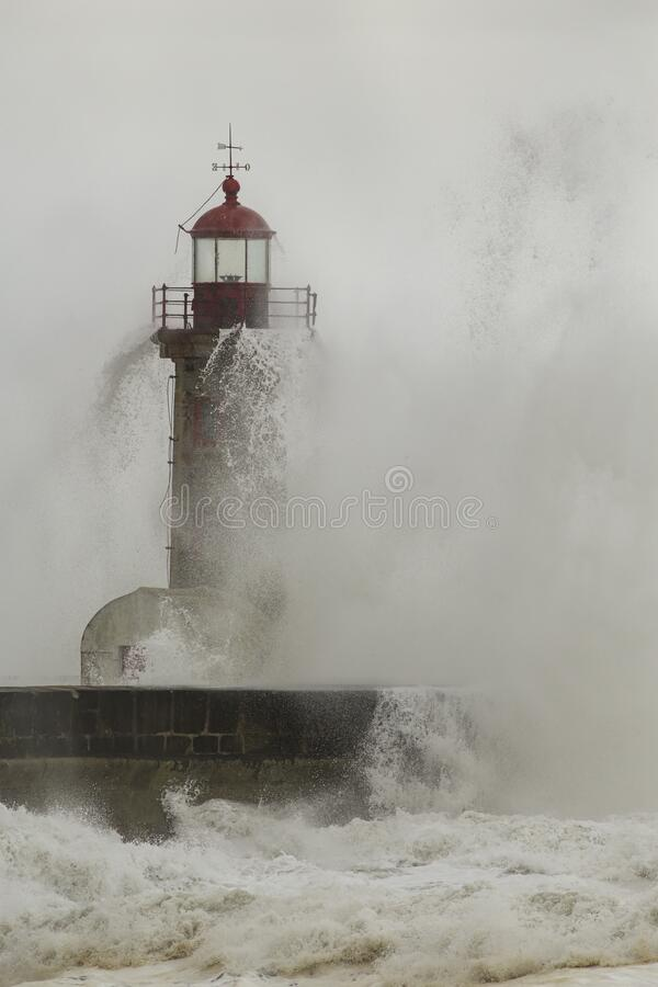 Free Old Lighthouse Covered By Stormy Waves Stock Photography - 221527382