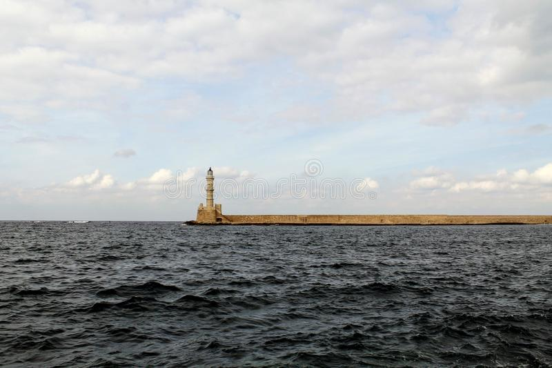 An old lighthouse on the horizon stock image