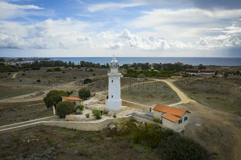 Old lighthouse on Mediterranean Sea shore in Paphos, Cyprus, aerial view from drone. Famous place in Paphos coastline.  royalty free stock photography