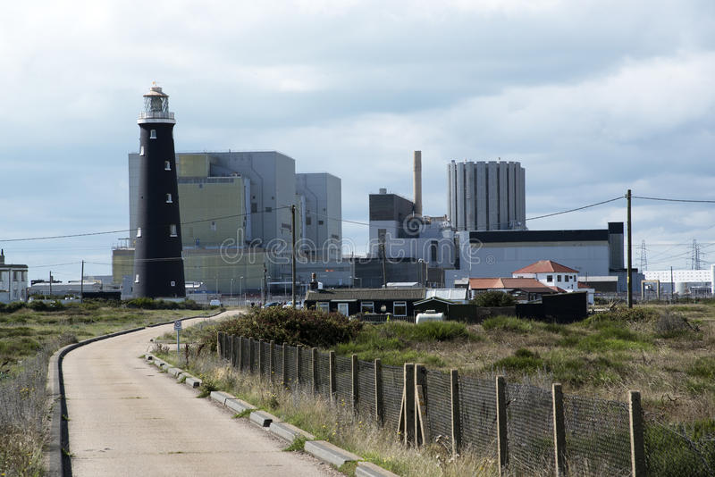 Old lighthouse and modern nuclear power station at Dungeness UK royalty free stock image