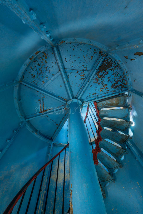 Free Old Lighthouse On The Inside. Red Iron Spiral Stairs, Round Window And Blue Wall. Stock Images - 67205144