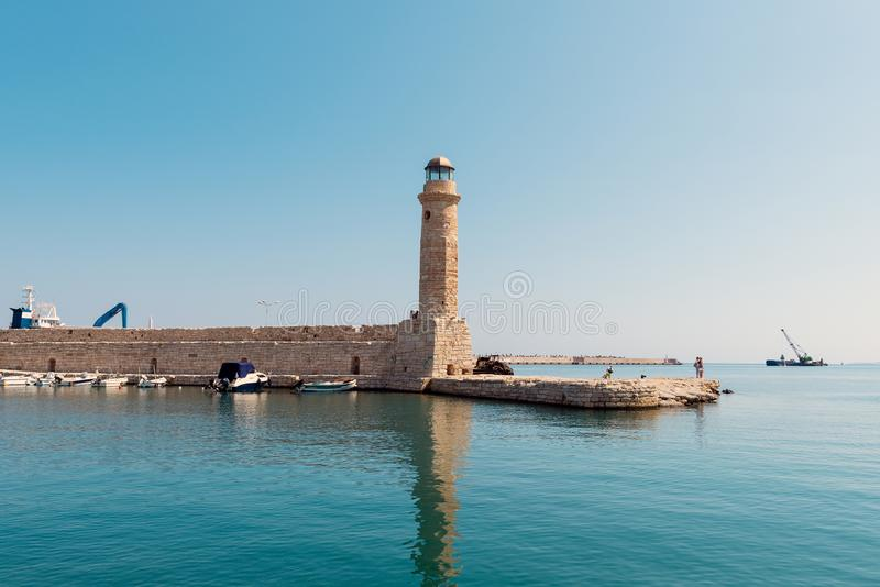 Old lighthouse at port of Rethymno town, Crete island, Greece.  stock image