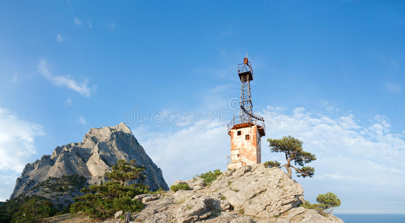 Download Old Lighthouse And Rock On Sky Background Stock Photo - Image: 13415734