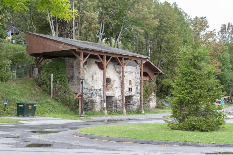 Old lime kilns serve as historic backdrop at Rockport Marine Par. Rockport, Maine, USA - September 19, 2018: Preserved lime kilns from 1890s at Rockport Marine stock photography