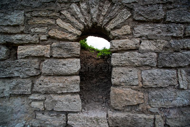 The old limestone wall is of the castle royalty free stock images