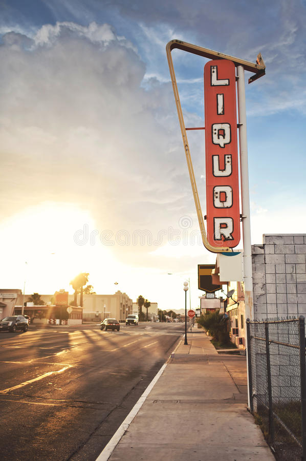 Old liquor store sign. Founded on Route 66, USA royalty free stock photography