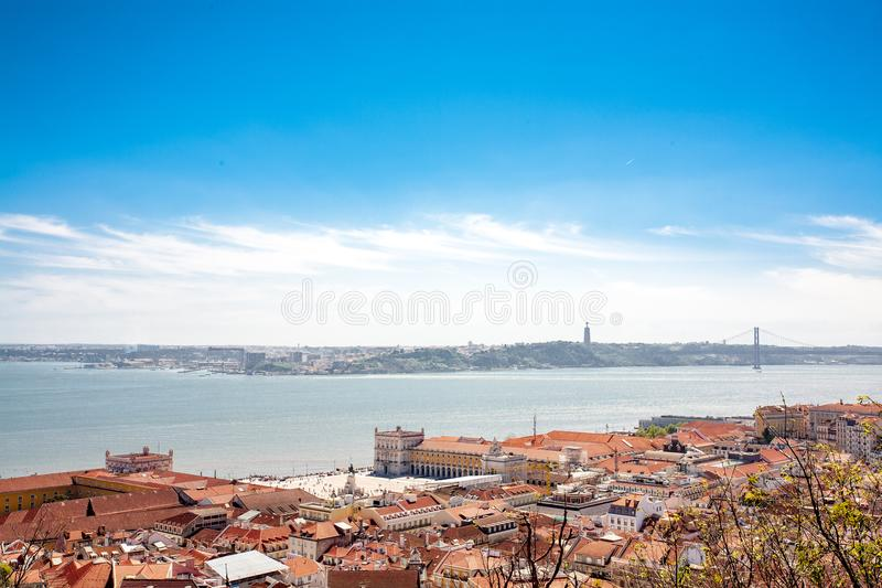 Old Lisbon Portugal panorama. cityscape with roofs. Tagus river. Old Lisbon Portugal steet. cityscape with roofs. Tagus river miraduro viewpoint. Spring and stock photo