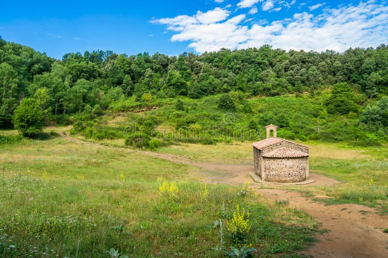 Old stone chapel in the middle of the volcano crater. royalty free stock image