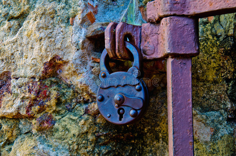 Old lock. Locking the old iron fence royalty free stock photography