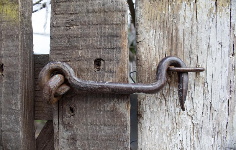 Old lock on the gate. lock on the door of an old rural home. real country style. close-up. focus on the castle stock photos