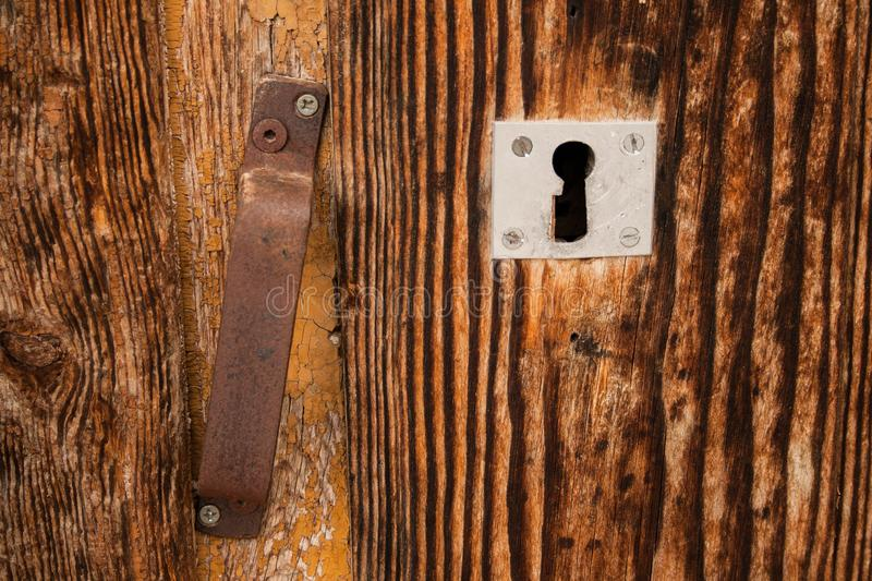 Old lock on old wooden door royalty free stock image