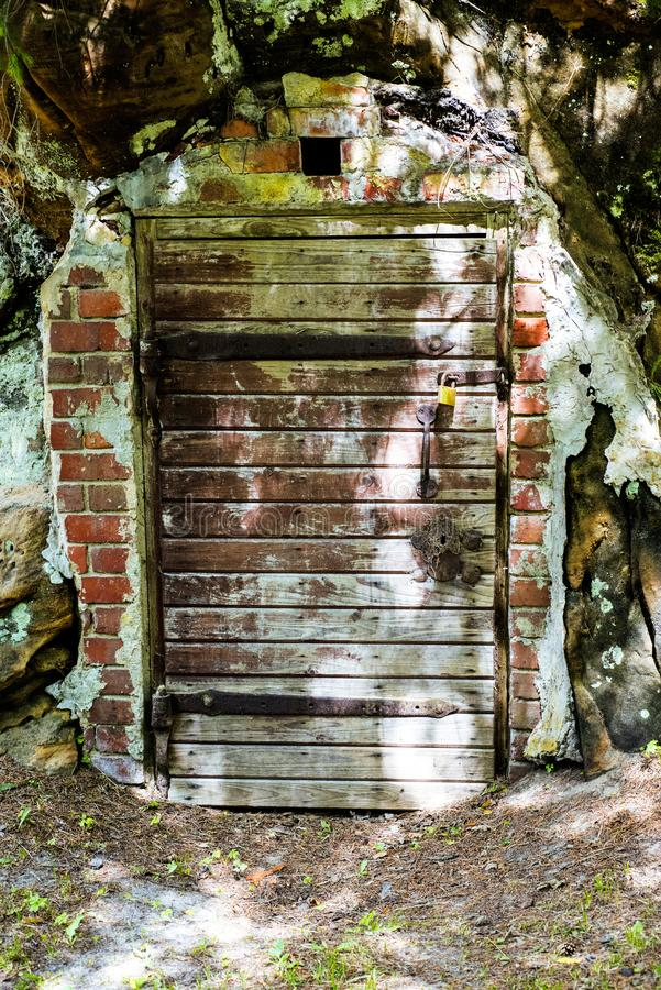 Old locked doors in cave. royalty free stock photos