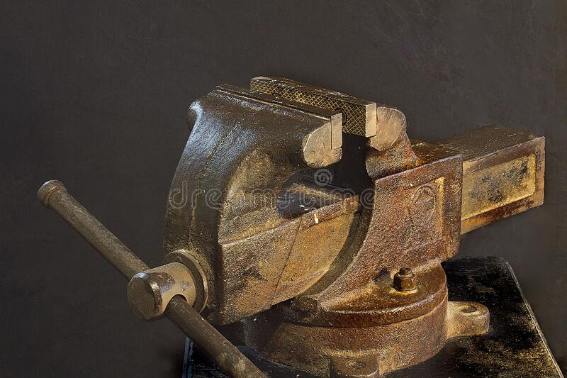 Old locksmith`s vise. Grandfather`s tool. Re tro tool. Tools of the past centuries. royalty free stock images