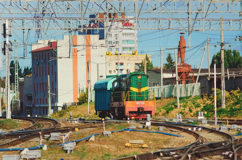 Old locomotive, rzd train rides on rails.Transport infrastructure of Russian. stock photos
