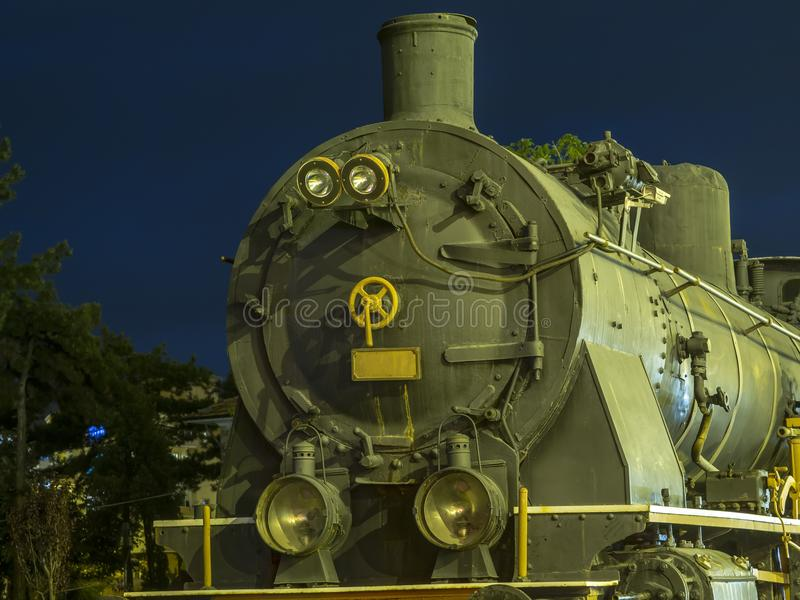 The old locomotive standing on the rails.  royalty free stock photography