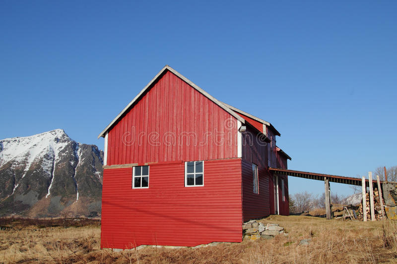 Old Lofoten's barn under blue sky. Traditional old Lofoten's stable and hay loft under a blue sky royalty free stock photography