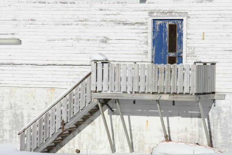 Old Lofoten's door. Old stairs and door of an abandoned fish factory in Ballstad, Lofoten islands royalty free stock photo