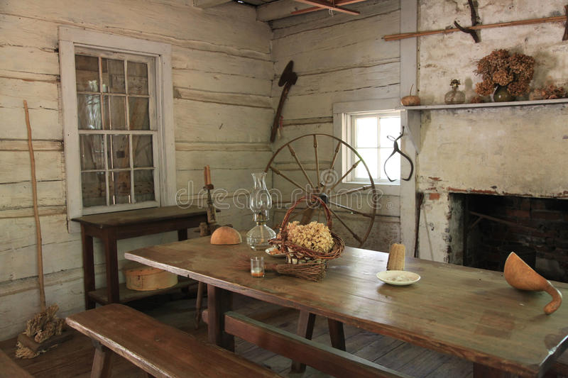 Old Log Cabin Interior. Old Log Cabin and Spinning Wheel royalty free stock images