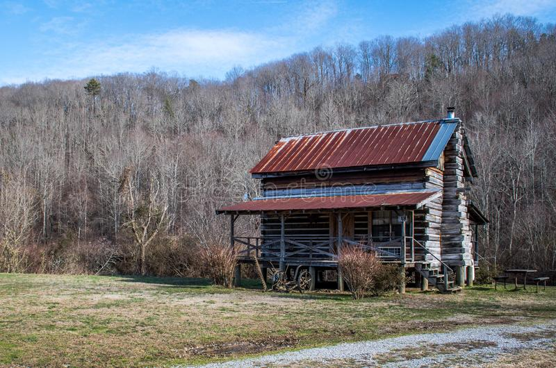 An old log cabin sitting amidst winter`s desolate landscape, southeastern Tennessee. USA royalty free stock image