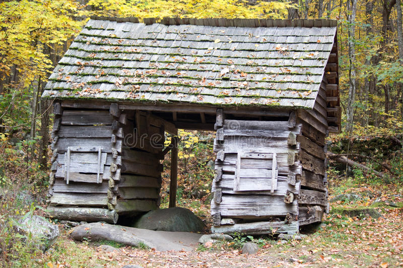 Old logging cabin in forest royalty free stock images