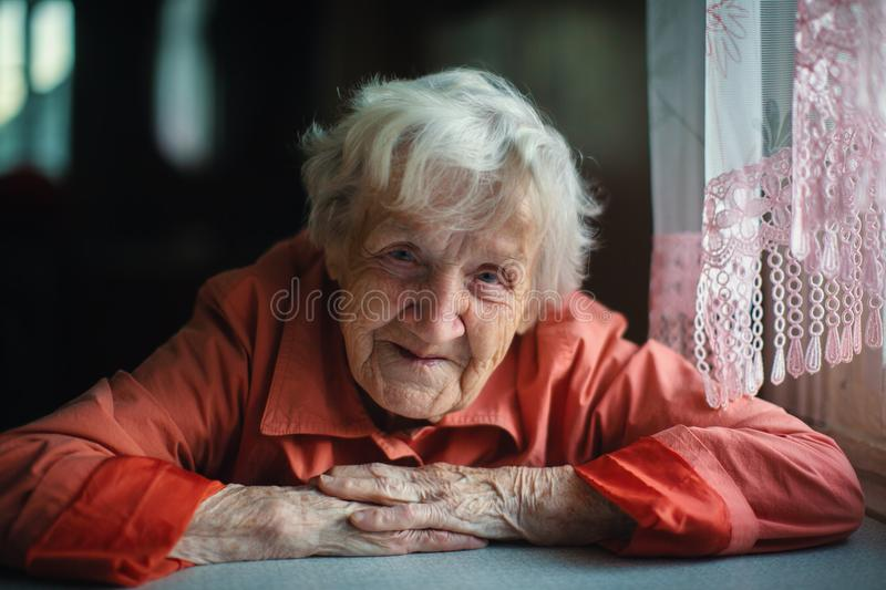 Download Old Lone Woman Sitting Near Window. Stock Photo - Image of retired, hair: 118098378