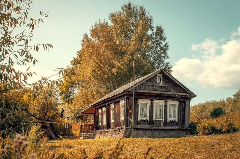 Old lonely house in a village in Russia. Retro style. View, architecture, building, country, countryside, farm, home, landscape, nobody, russian, summer stock image