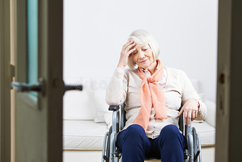 Old lonely woman in wheelchair royalty free stock photography