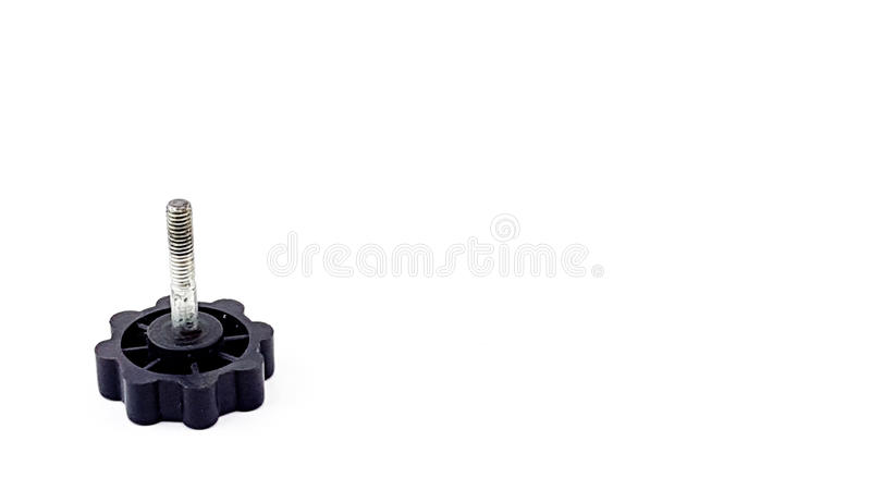Old long threaded nut with plastic connector with notches. Isolated royalty free stock images