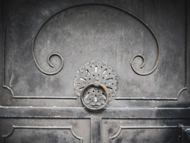 Old looking door with knock and oriental ornaments with retro style design as an old entrance to a historical building stock photo