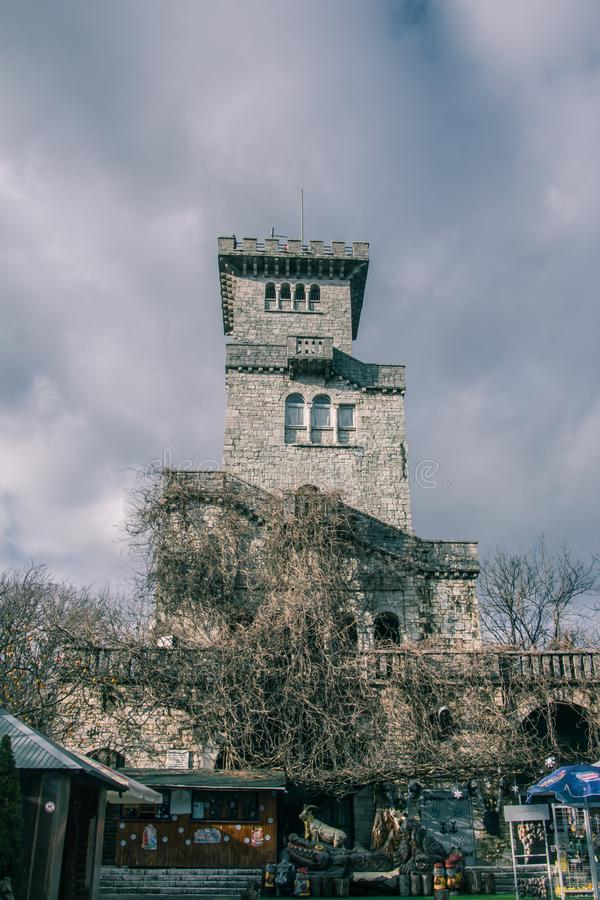 The old lookout tower on mount Akhun. Ancient architecture. Historical monument. The mountains and the sky. clouds float royalty free stock image