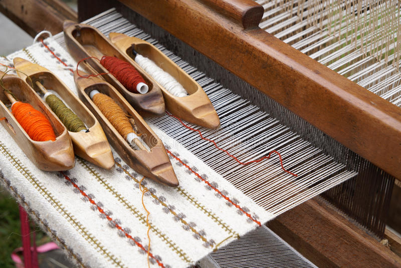 Old loom. Old folk loom and threads royalty free stock photo