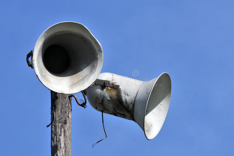 Old loudspeakers. With blue sky background stock photo