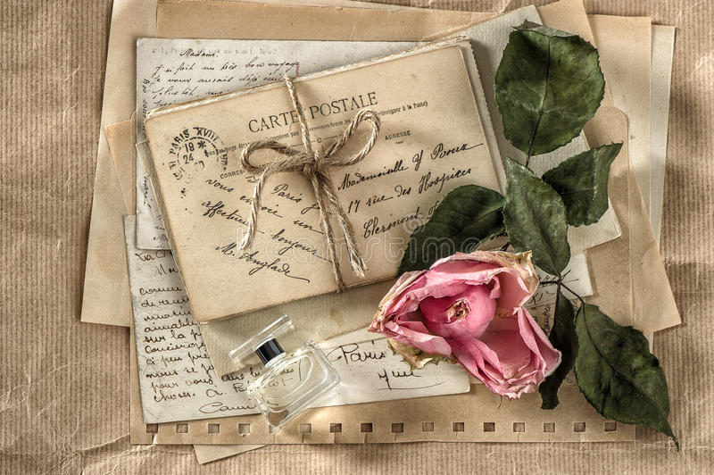 Old love letters, perfume and dried rose flower. scrapbook paper royalty free stock images