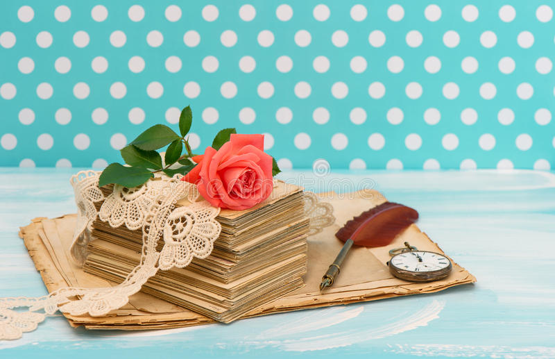 Old love letters and postcards with pink rose flower. Nostalgic sentimental still life. Retro style designed picture royalty free stock images