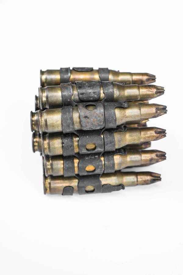 Old machine gun's bullets on white background. Old machine gun bullets on white background royalty free stock photo