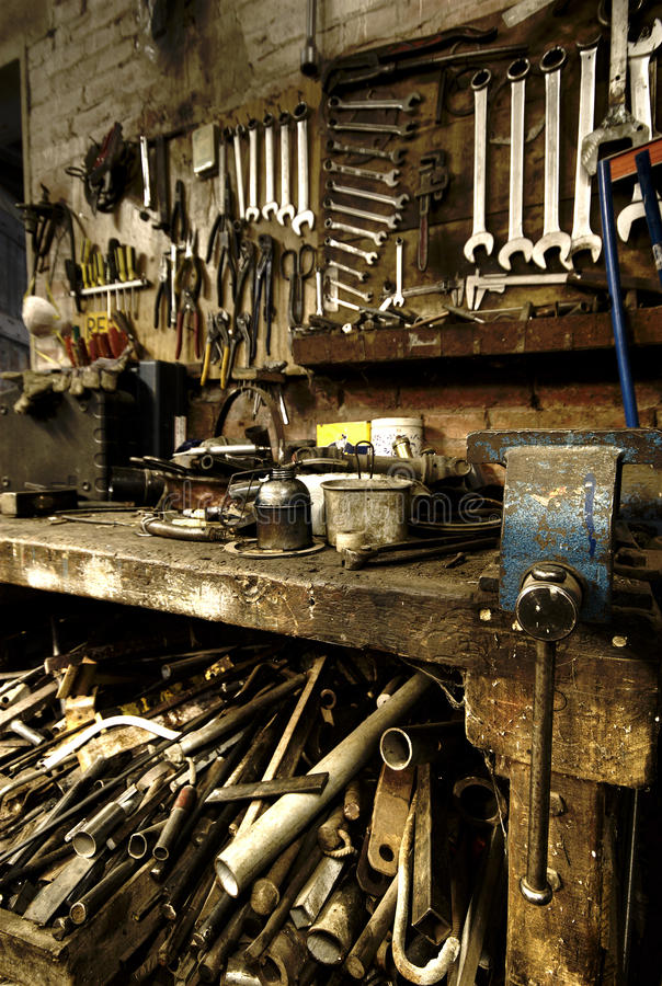 Old machine shop. An old machine shop full of tools royalty free stock image