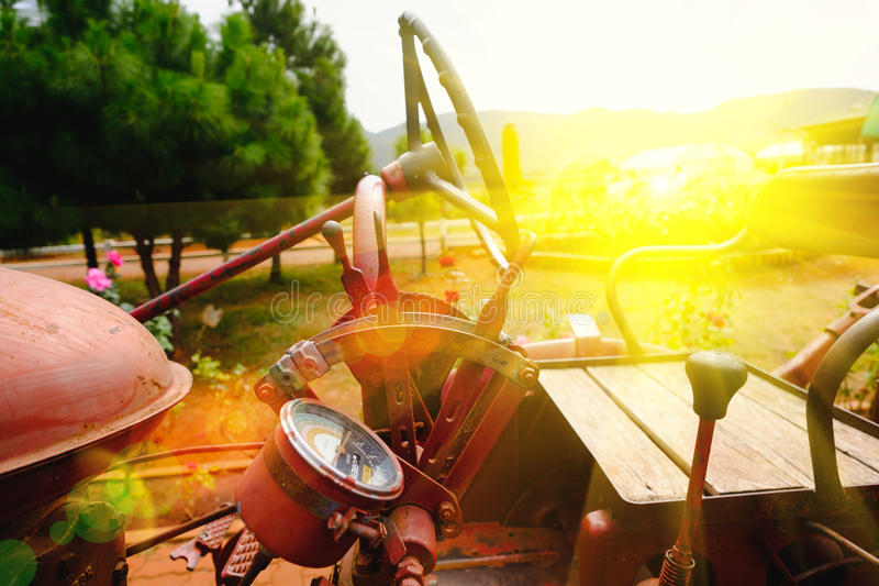 Old machine of tractor. Soft focus and lighting flare effect stock images