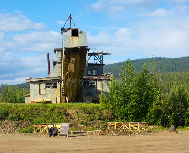 An historic dredge on display at a gold-mining operation in alaska. An old machine used during the klondike days as seen at chicken alaska royalty free stock photo