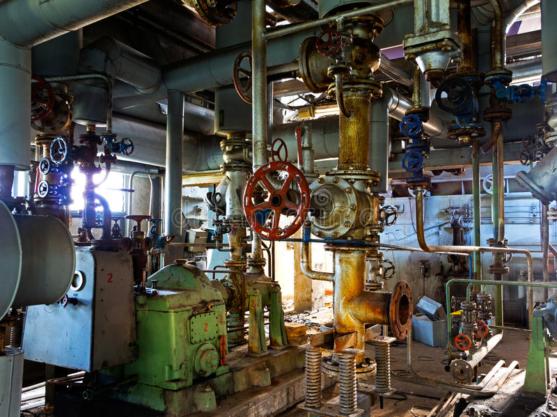 Old machinery of abandoned factory from inside stock image