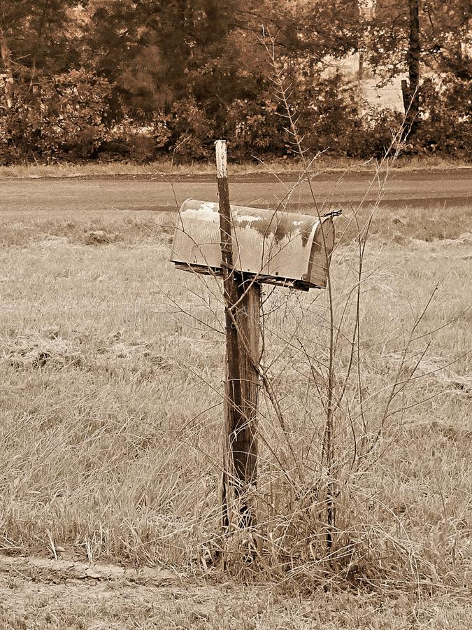 Old mailbox on side of country road in Mississippi royalty free stock photos